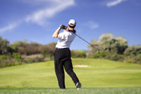 Photograph of Golfer Hitting Golf Ball